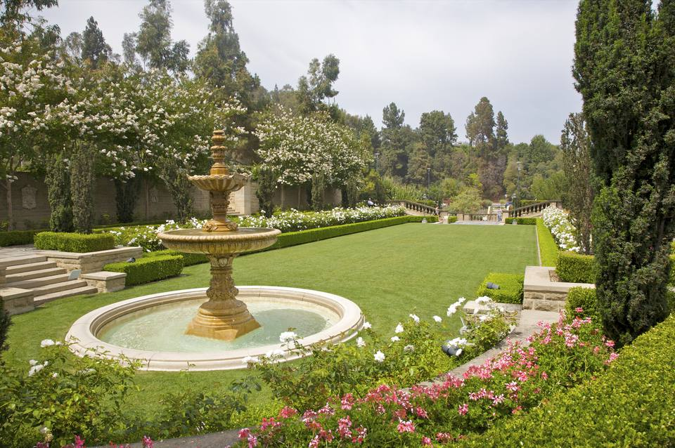 Large water fountain set in formal landscape.