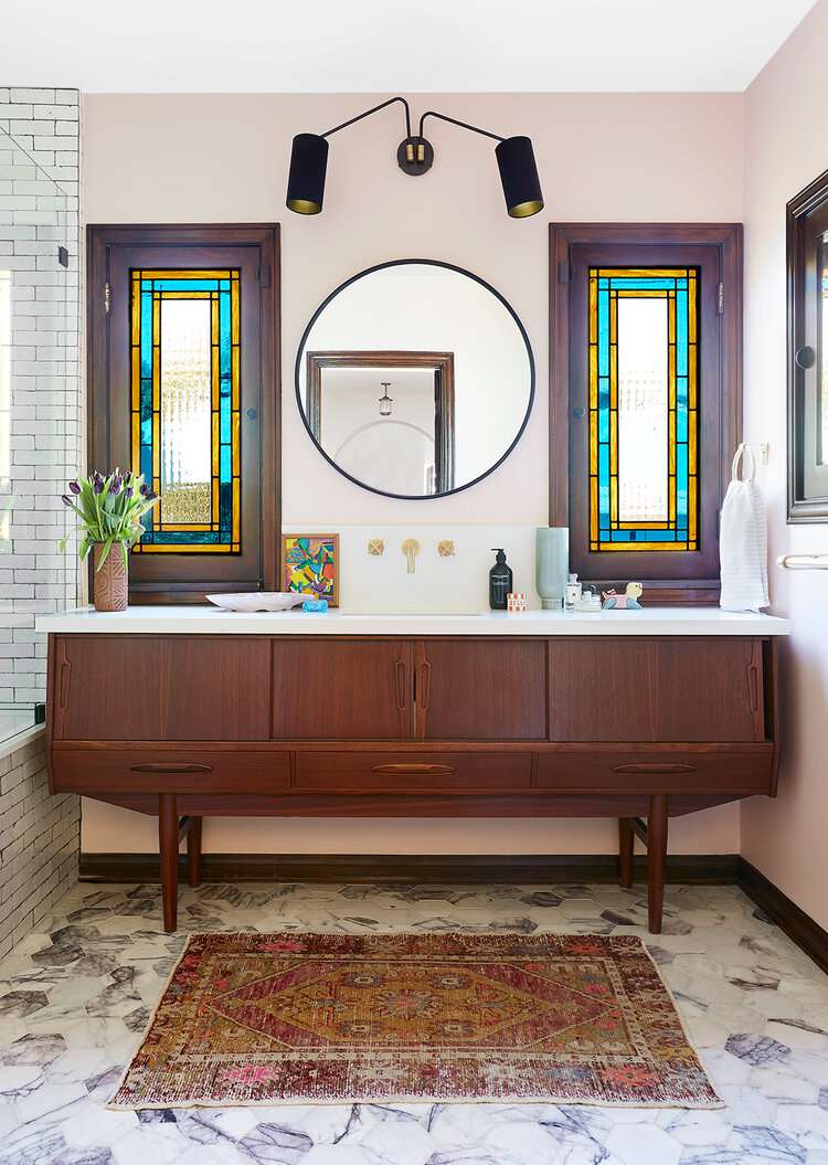 stained glass window in art decor bathroom