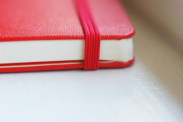 Close up of a red moleskine notebook