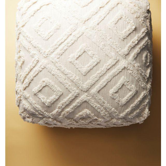 An overhead shot of a diamond-textured pouf