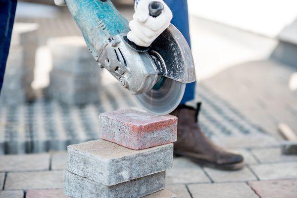 Builder cutting pavers