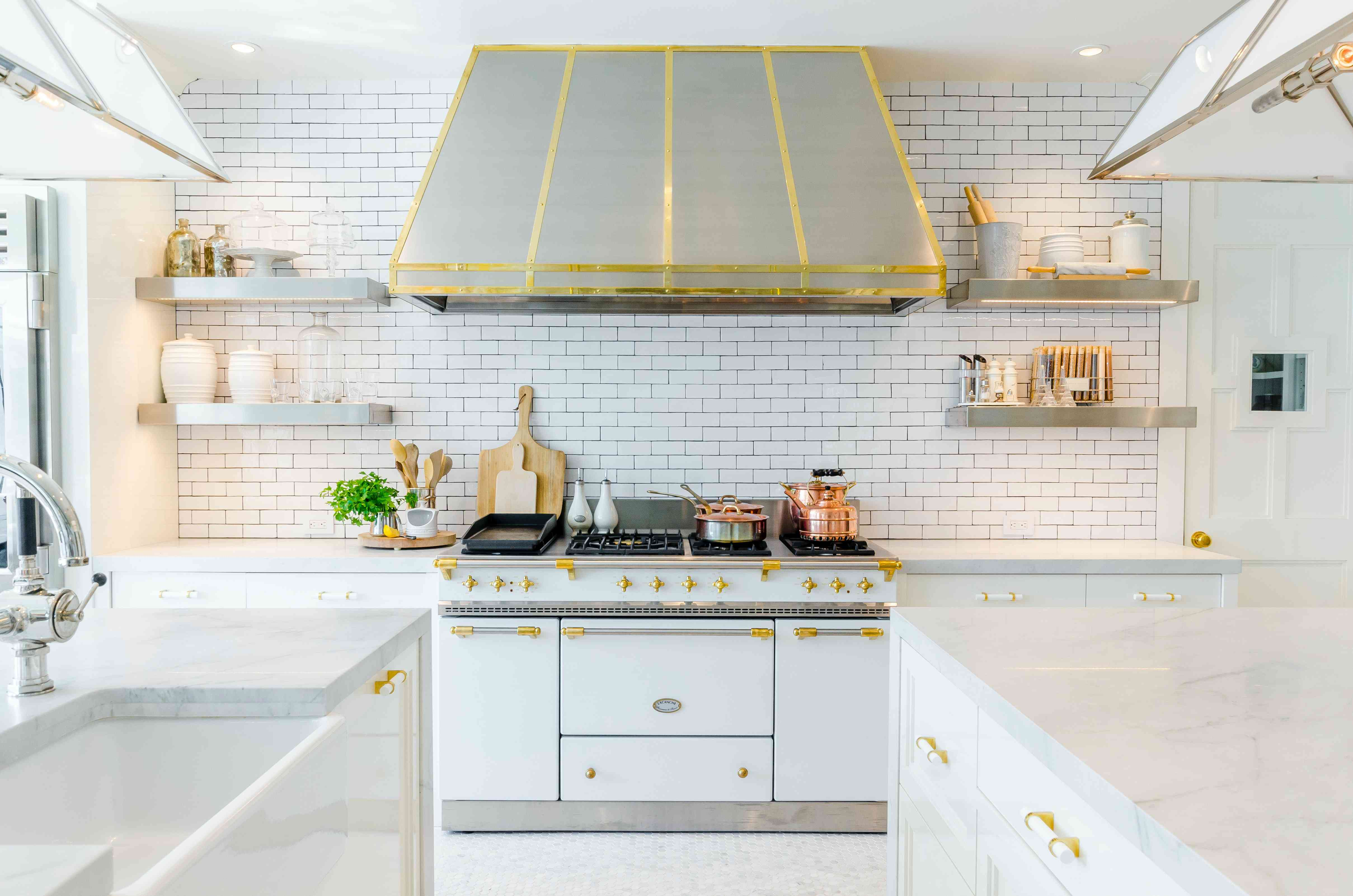 White and gold kitchen with subway tile