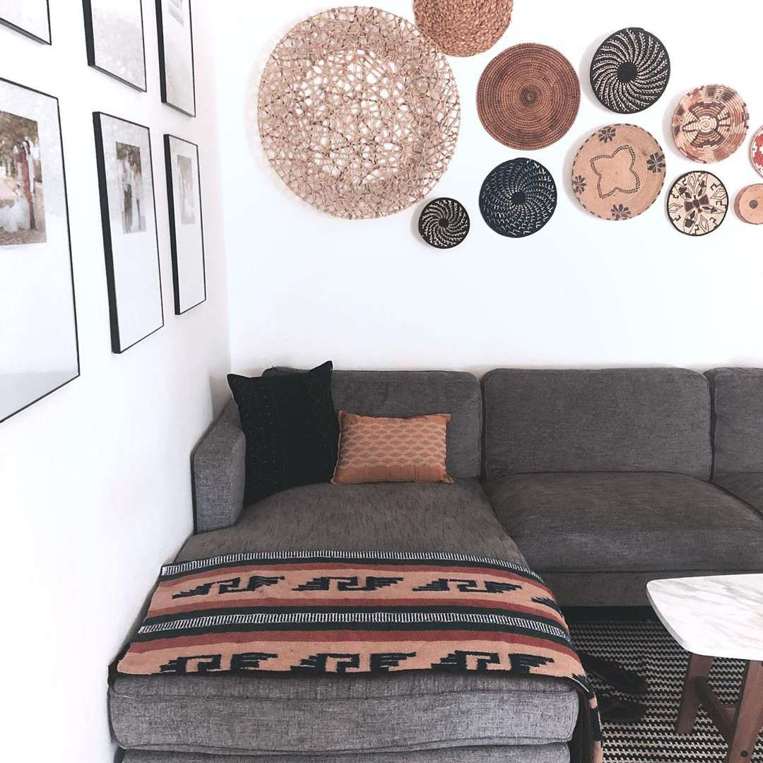 Couch with basket decor above