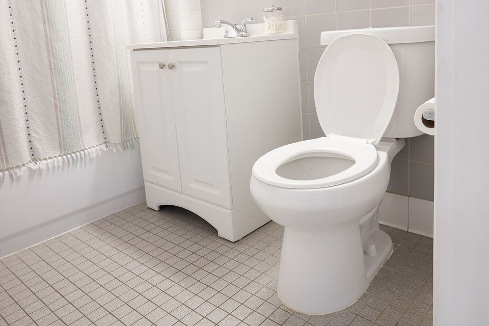 light and airy bathroom with toilet