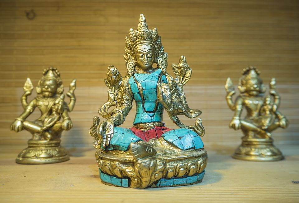 Tibetan brass and stone statue of Green Tara close-up