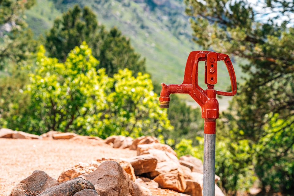 Close-Up Shot of a Variable Flow Freezeless Yard Hydrant for Irrigation Outdoors in a Xeriscaped Yard in the Rocky Mountains in the Summer