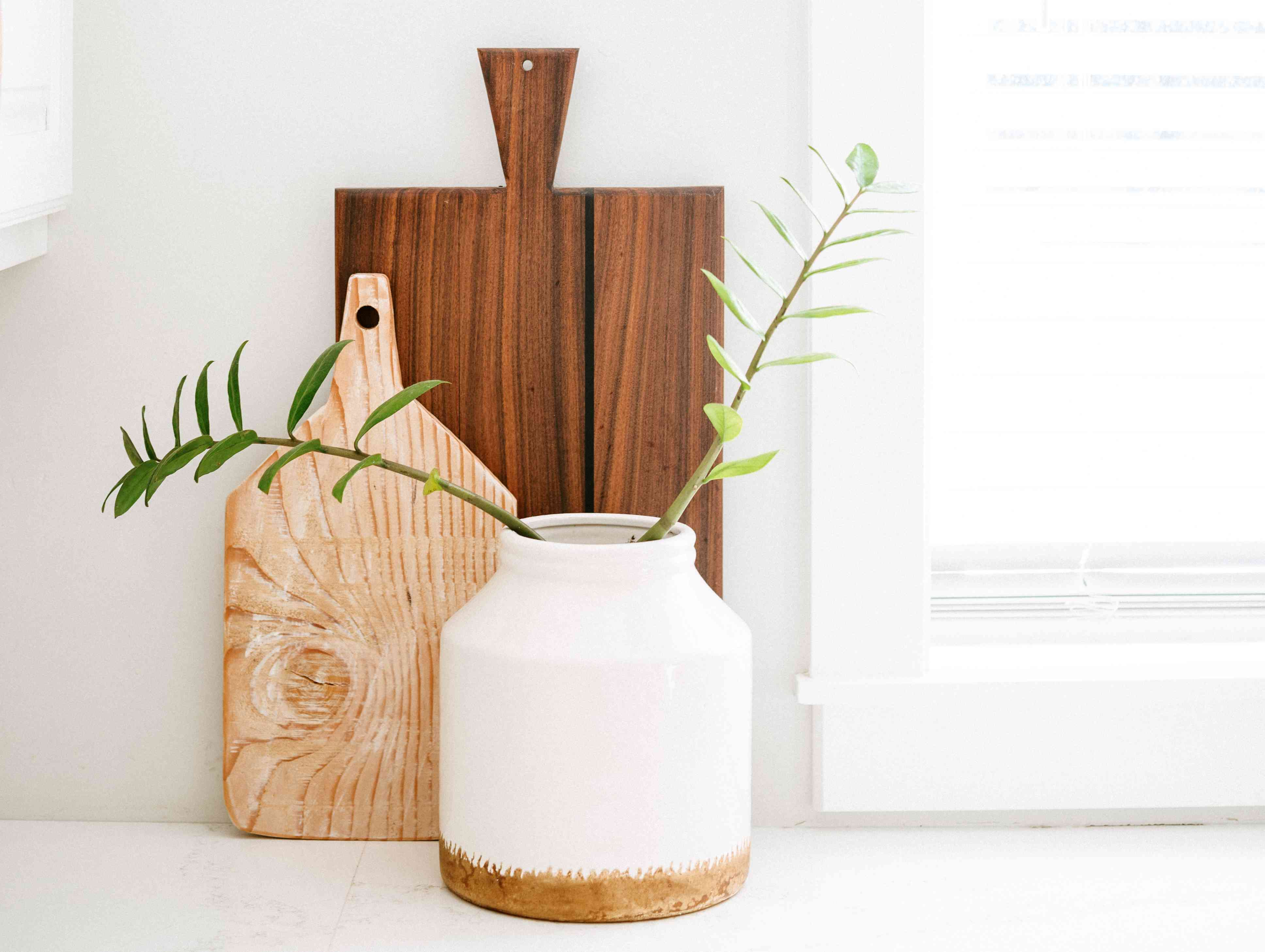 cutting boards artfully displayed on a counter