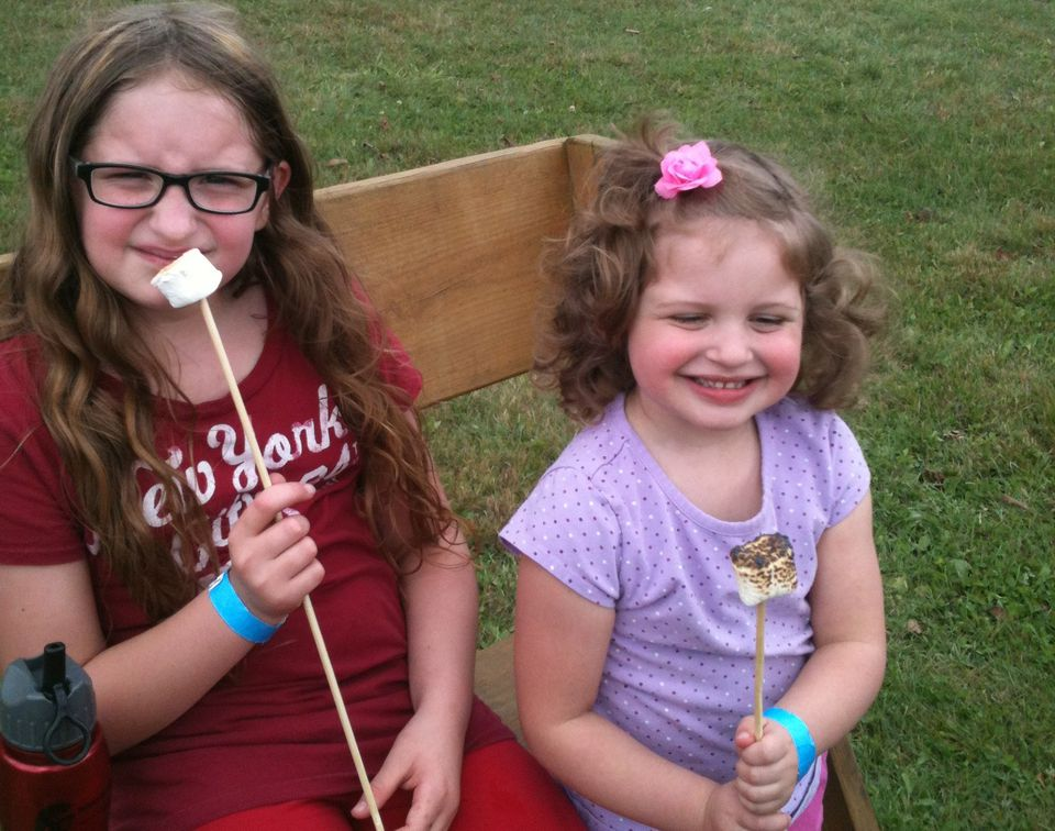 kids with marshmallows on roasting sticks