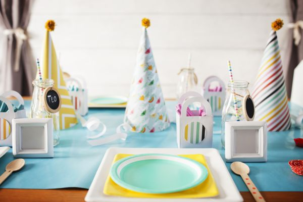 Party hats on decorated table during birthday party