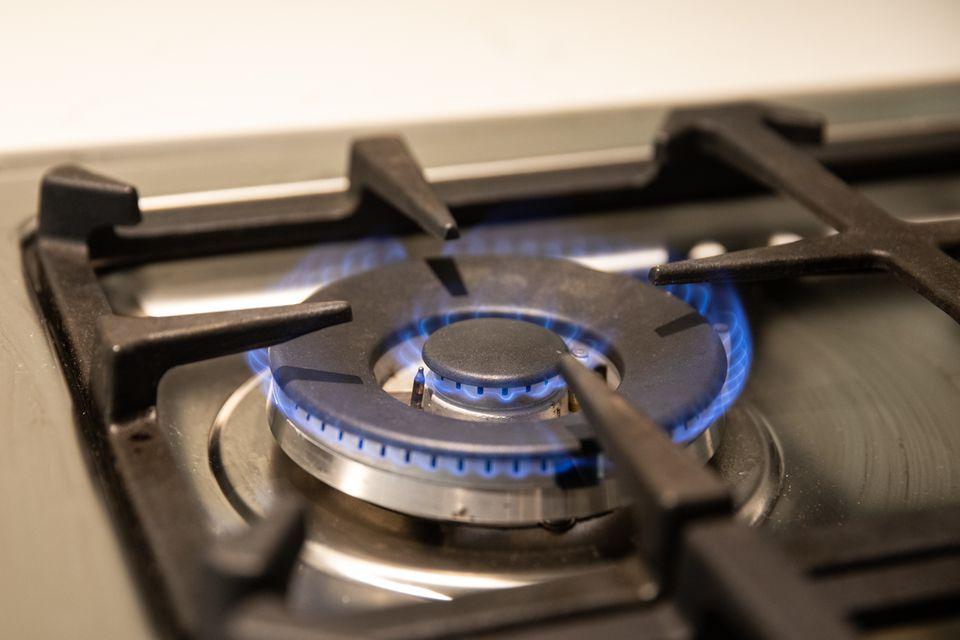 lit gas burner on a stove