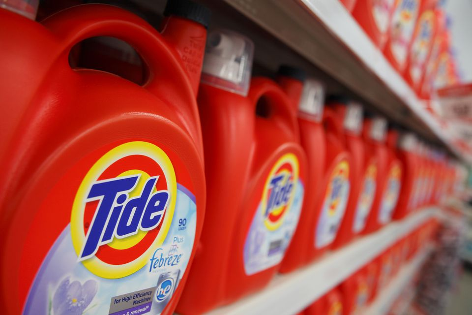 A supermarket shelf covered in Tide detergent