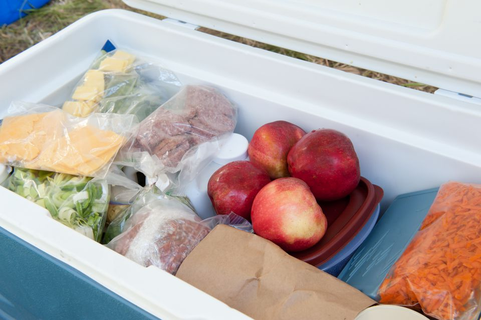 Blue igloo cooler, filled with picnic food