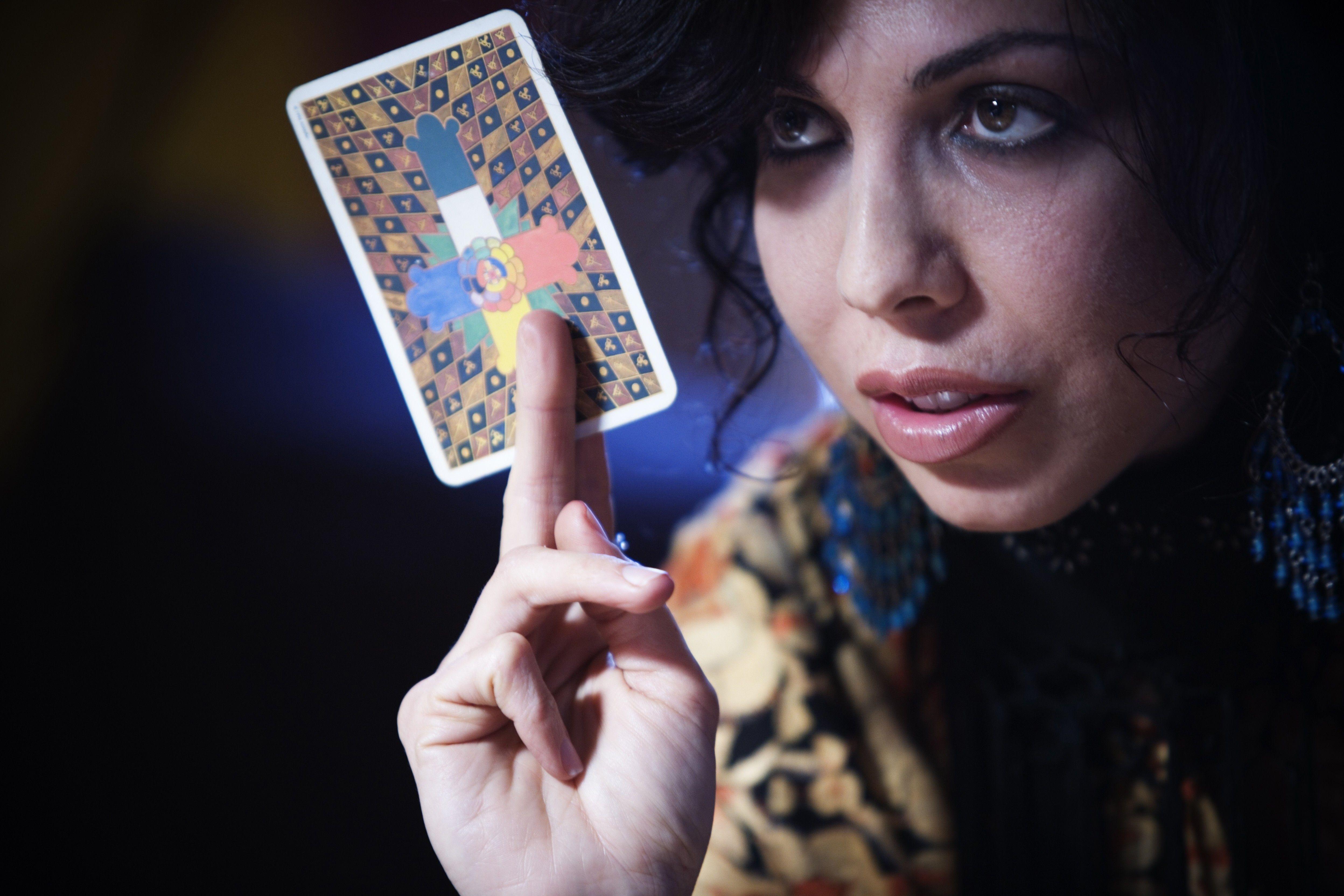 person holding a tarot card