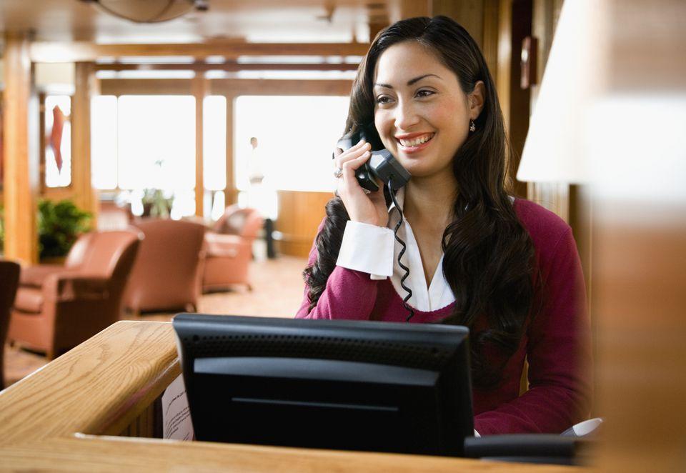 Restaurant hostess taking reservations