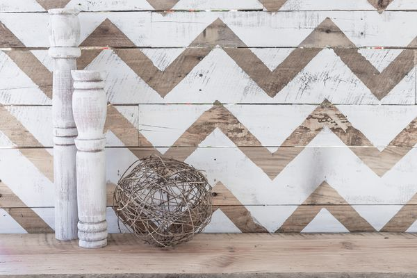 chevron pattern on wood planks with rustic candle pillars