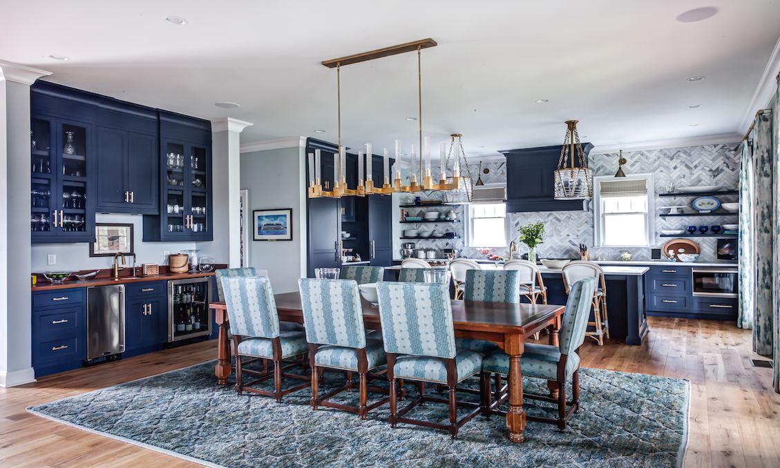 Blue and gray kitchen with marble herringbone backsplash
