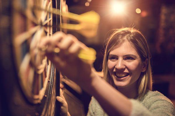 woman playing darts