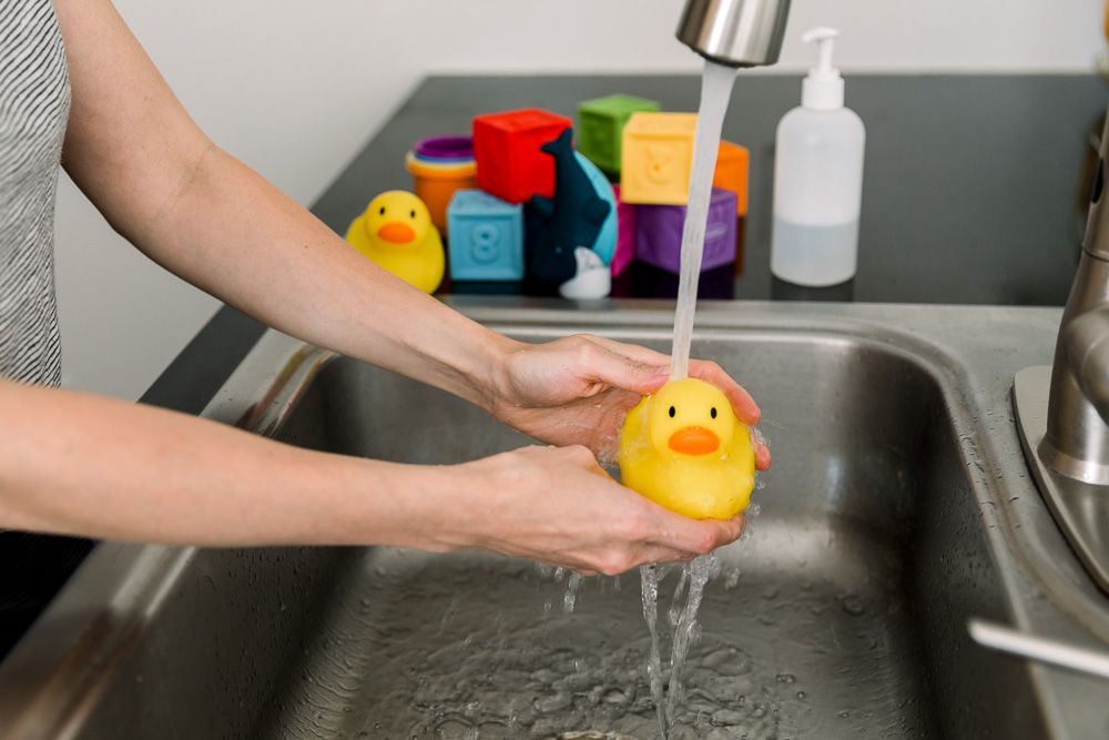 washing baby toys with soap and water