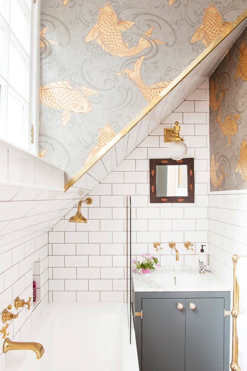Small bath with gold wallpaper