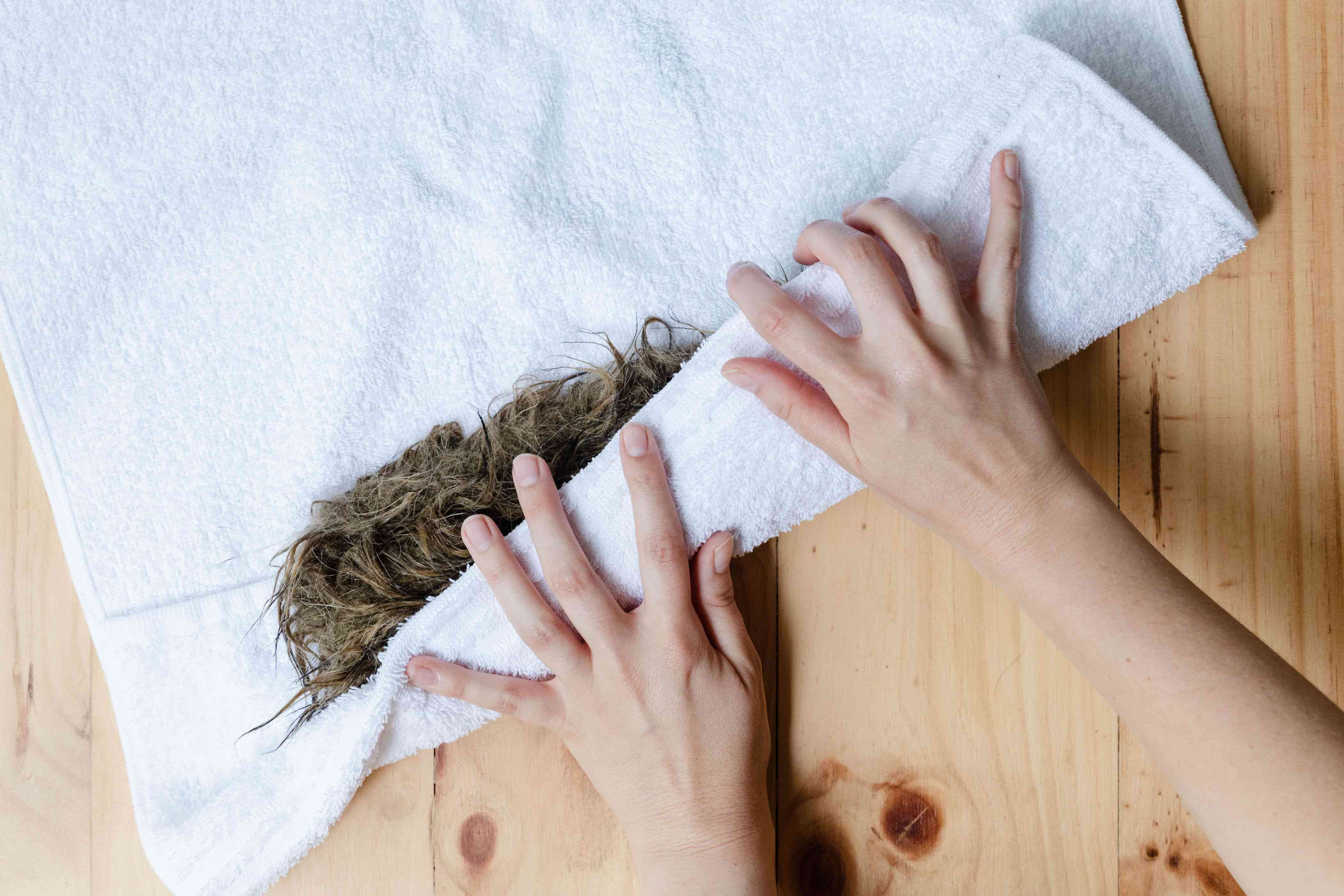 Rolling the damp faux fur in a towel