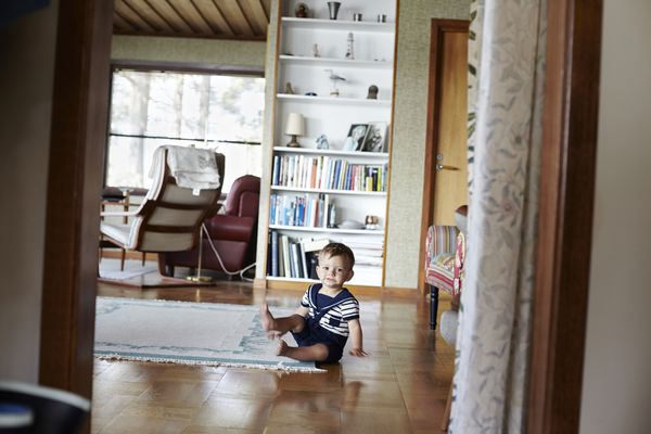 baby in front of tall bookshelf