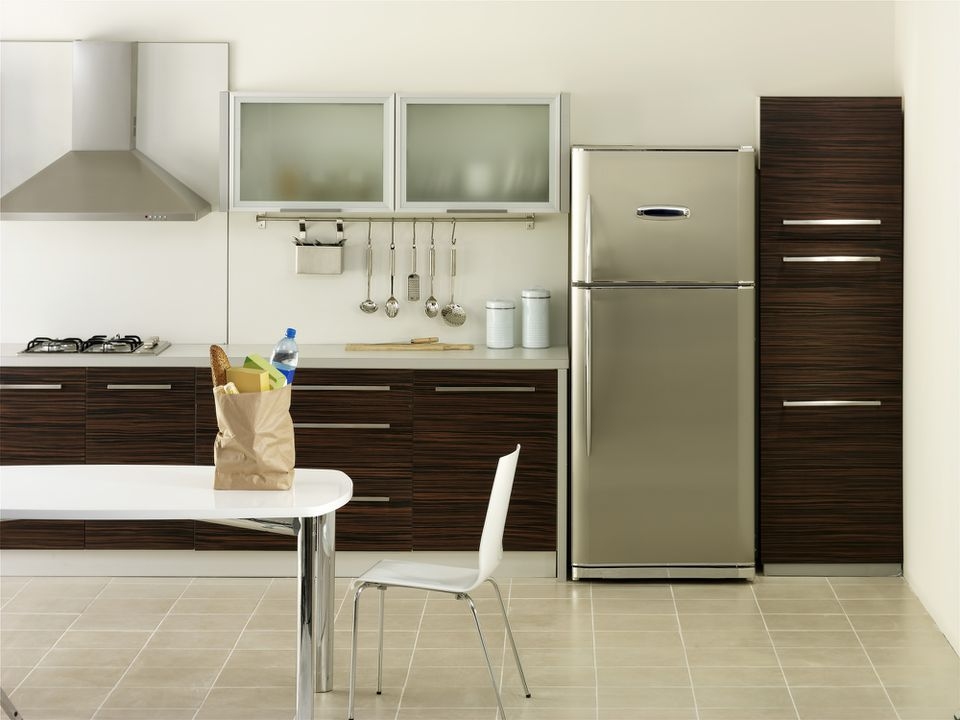Refrigerator in a nice clean kitchen