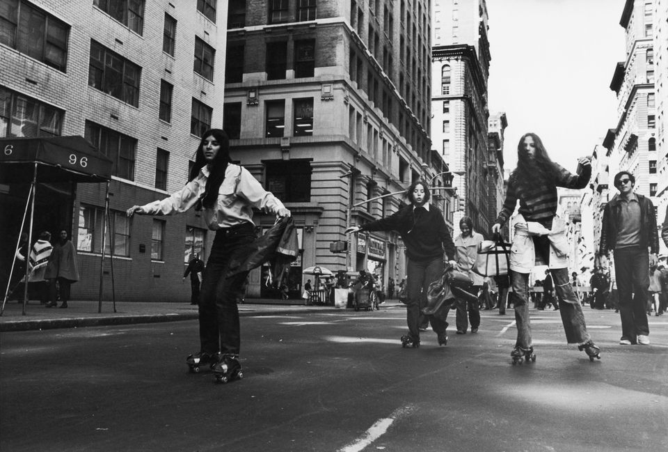 New Yorkers rollerskating in a black and white photo
