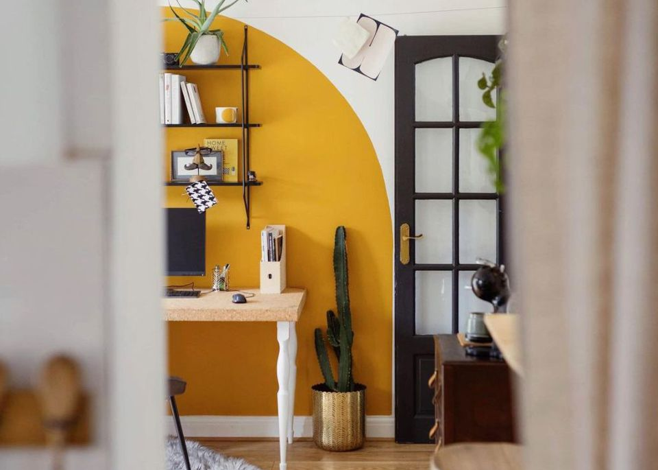 yellow painted arch in an office