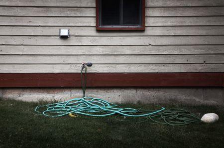Hosepipe outside wooden house