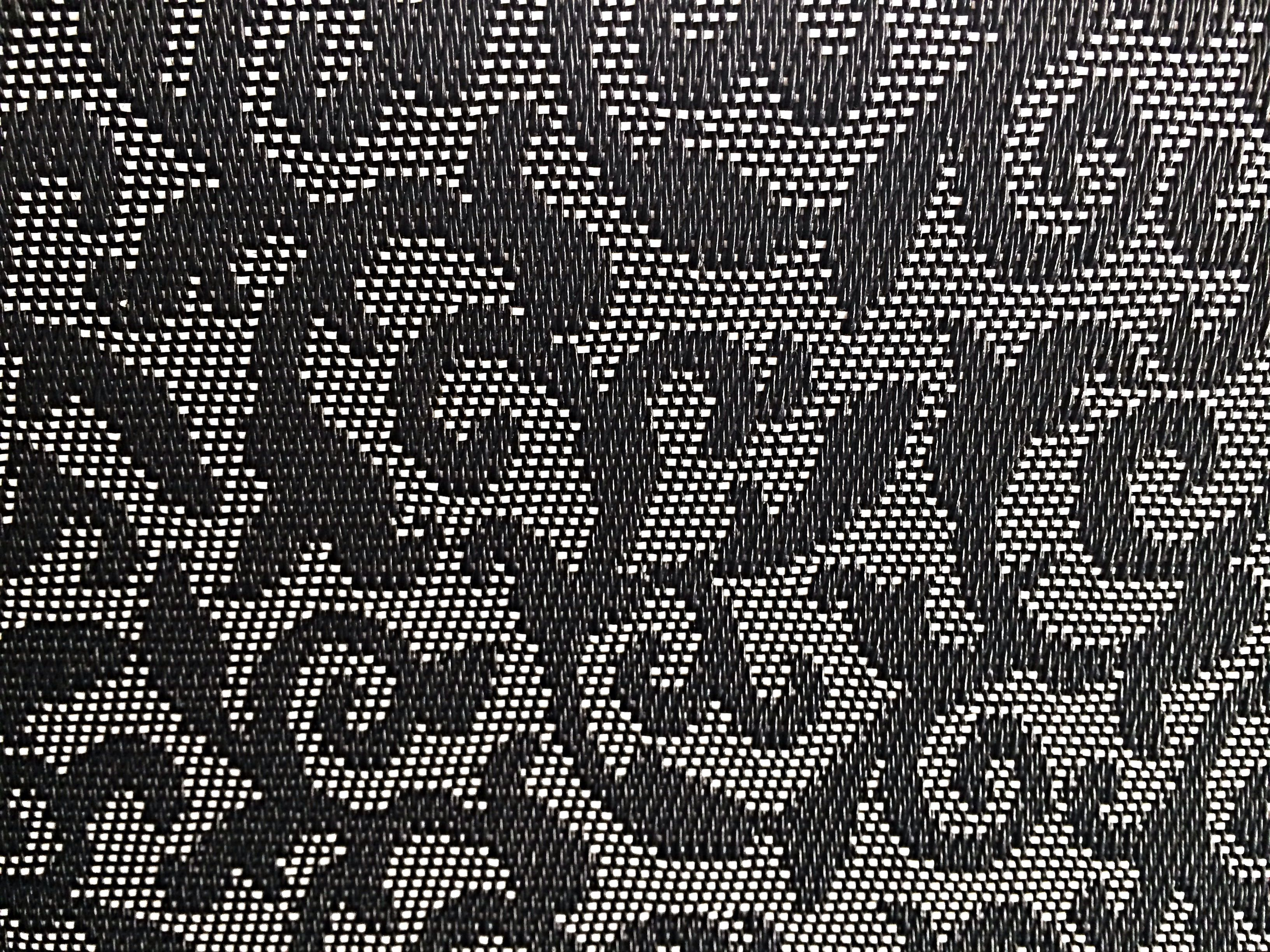 A close-up of vine-patterned upholstery