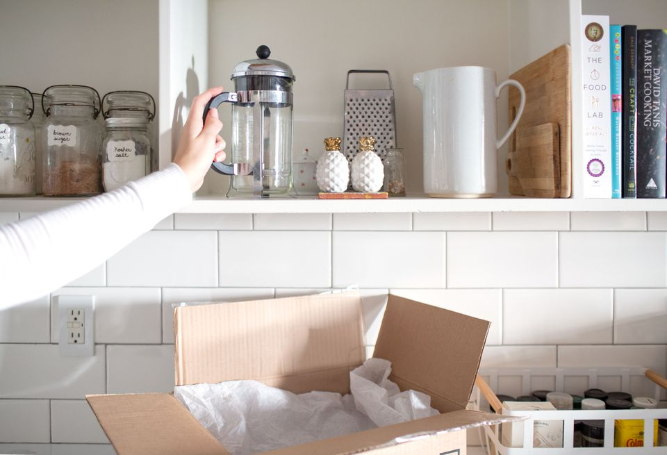 taking kitchen items out of a moving box