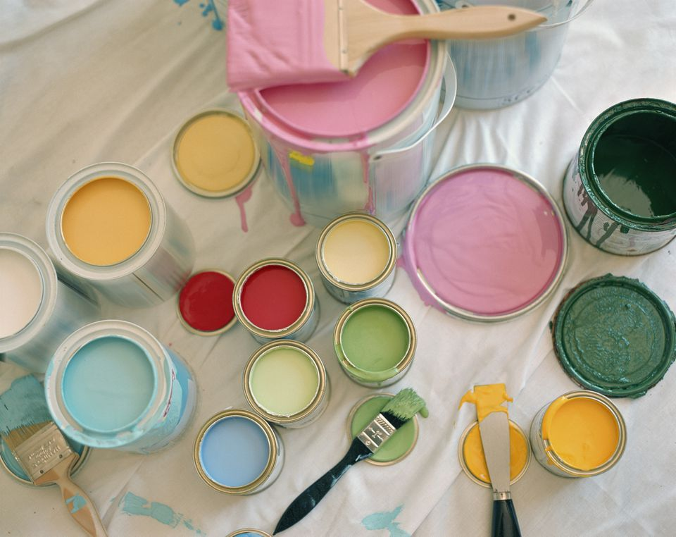 Opened paint pots on floor, close-up, overhead view