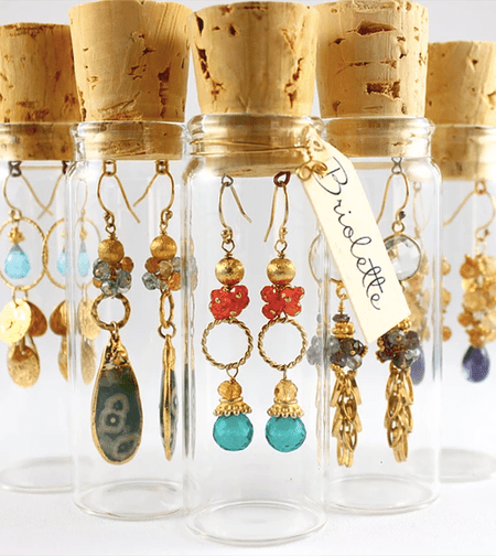 Earrings In Small Jars With Corks