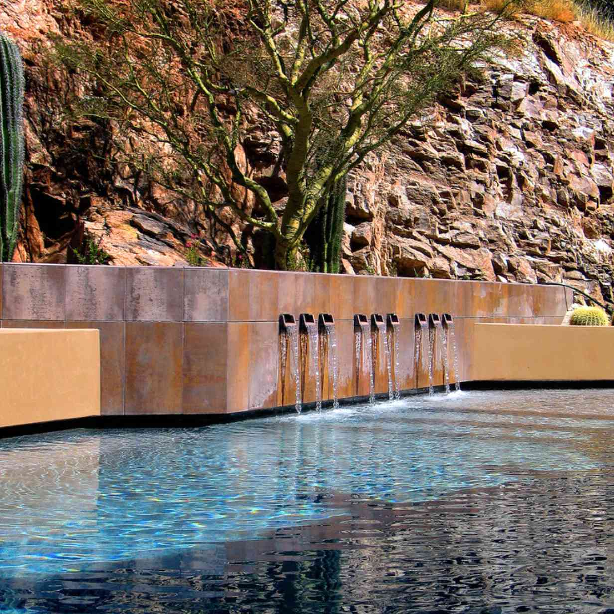 Pool with scupper water features