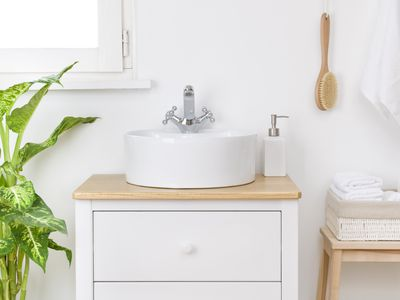 Bathroom sink with body care accessories and spa towels basket