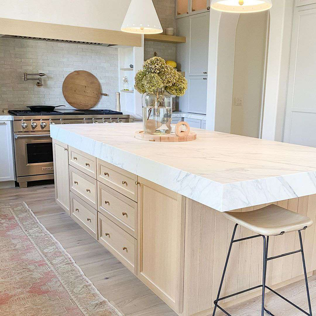 Kitchen island with blond wood stain