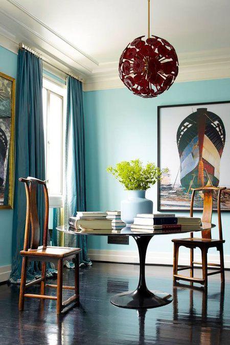Light Blue Dining Room With Unusual Lighting Fixture