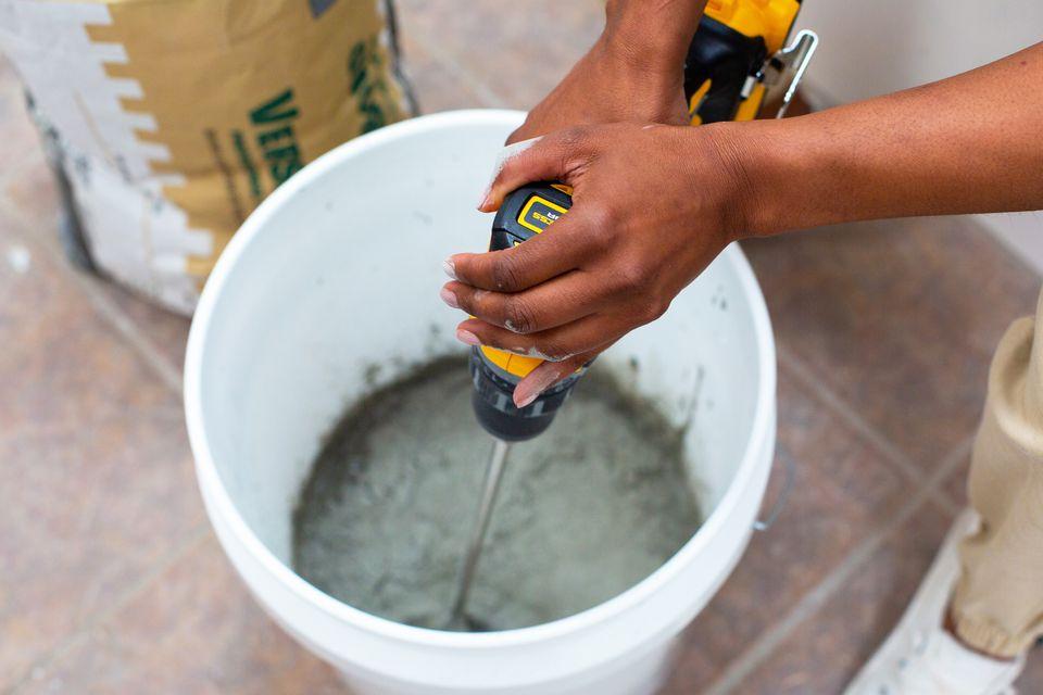 person mixing concrete