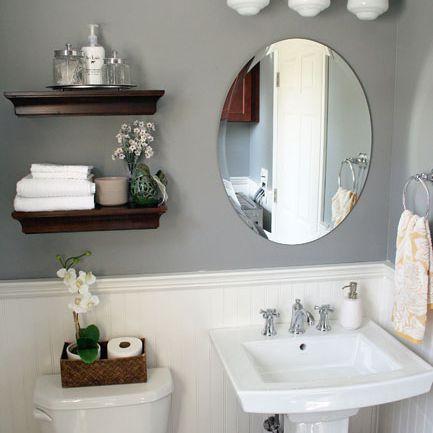 A beadboard bathroom with gray walls