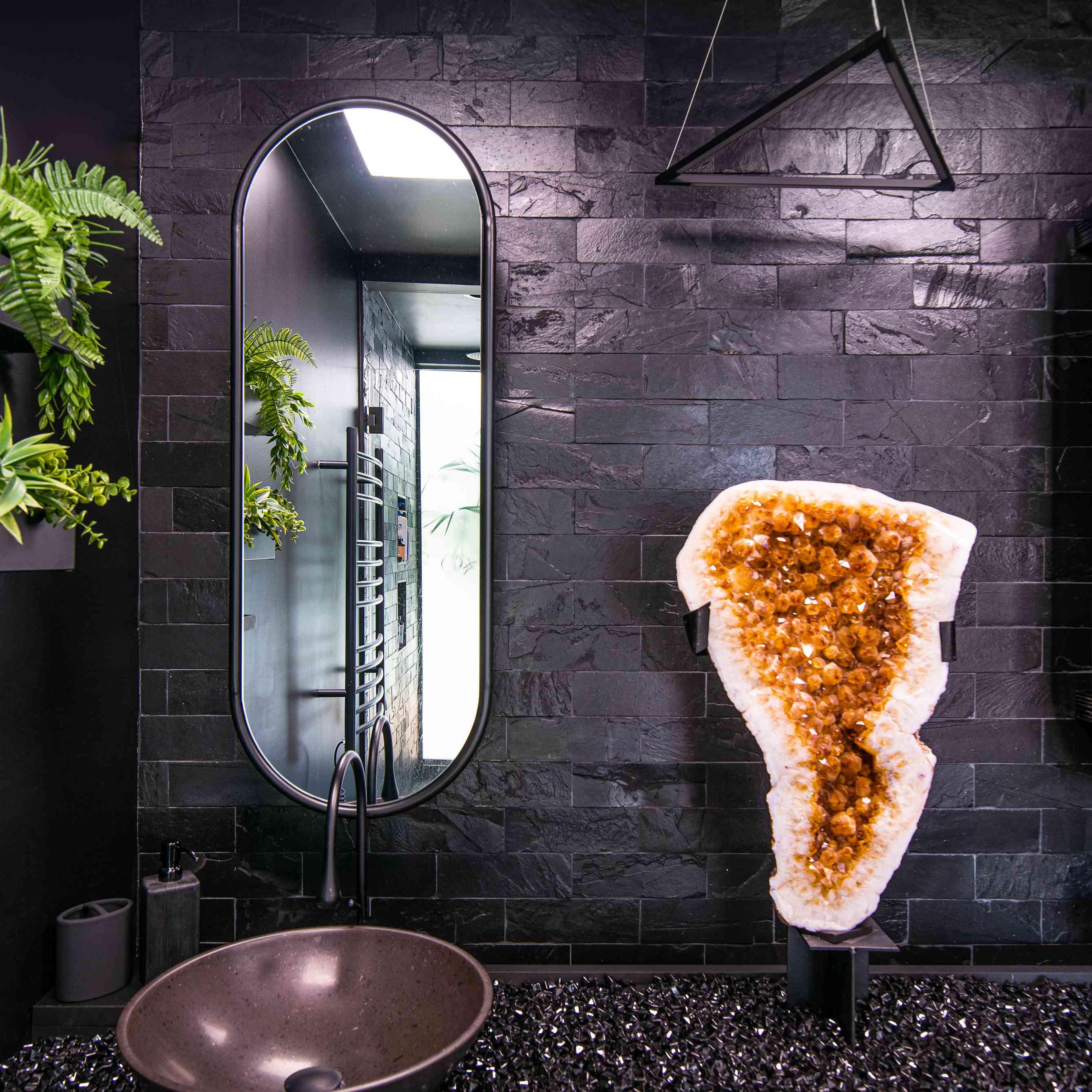Black bathroom with a healing crystal