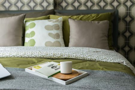 Peaceful Green And Gray Retro Bedroom Style With Cup Of Tea Books