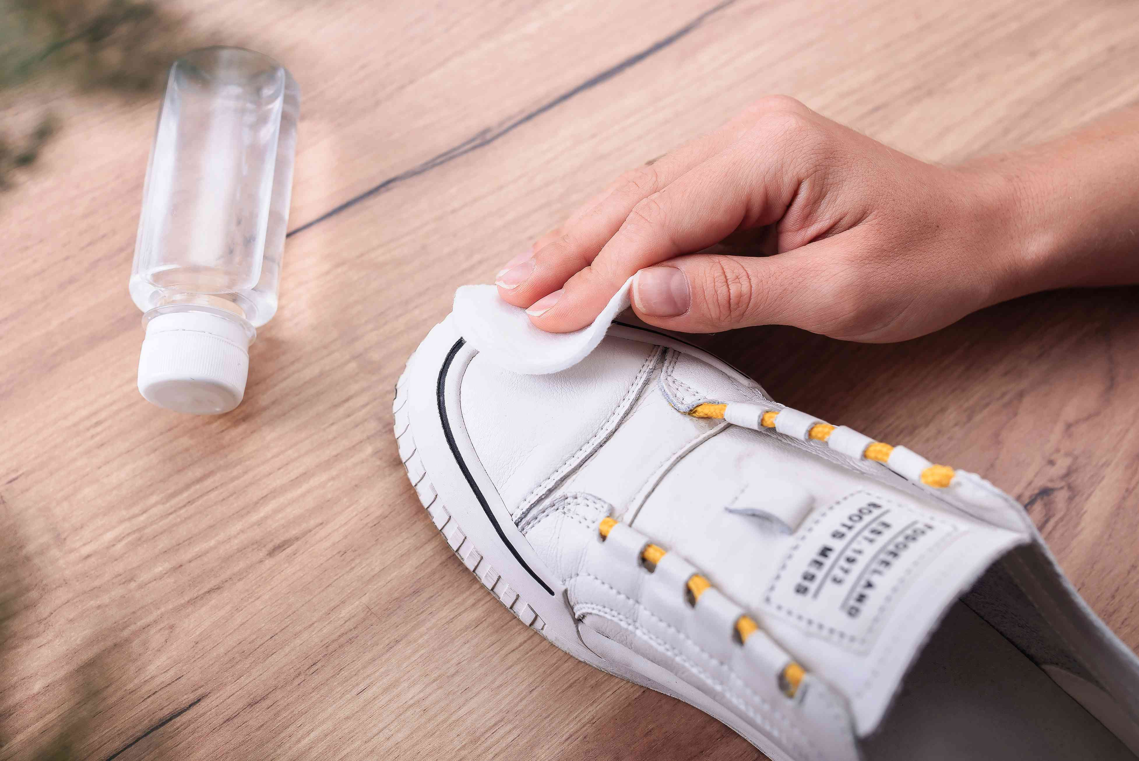rubbing the sap stain off of a shoe