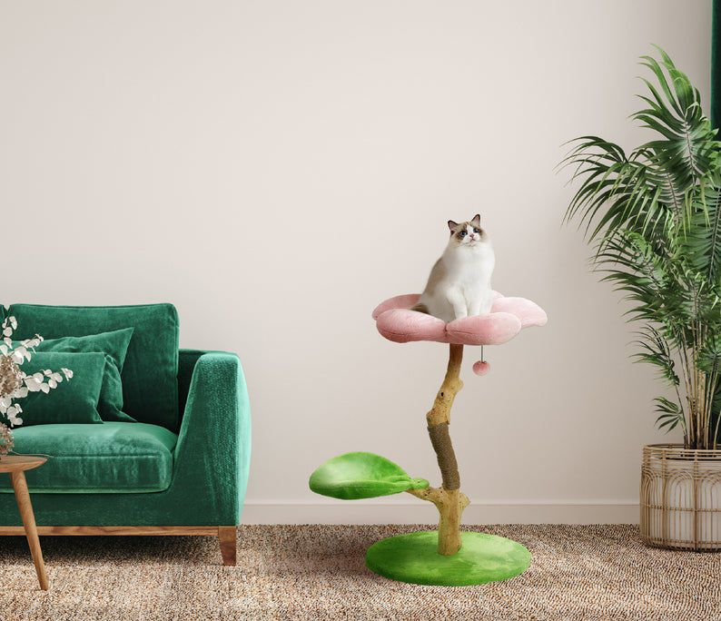a wooden floral cat tree with pink
