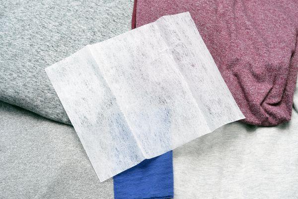 Fabric softener sheet on folded laundry