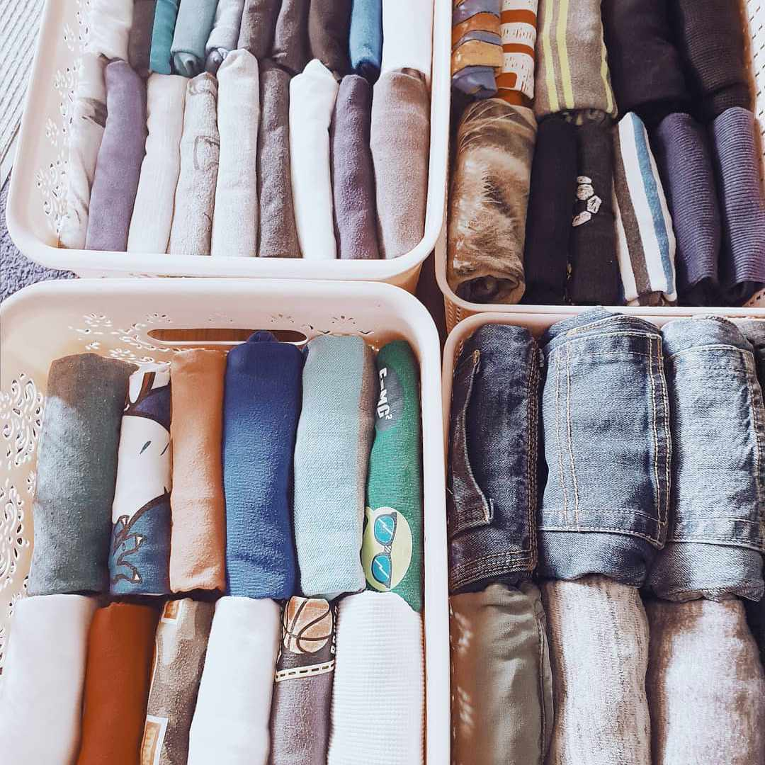 Organized drawer of clothes in bins