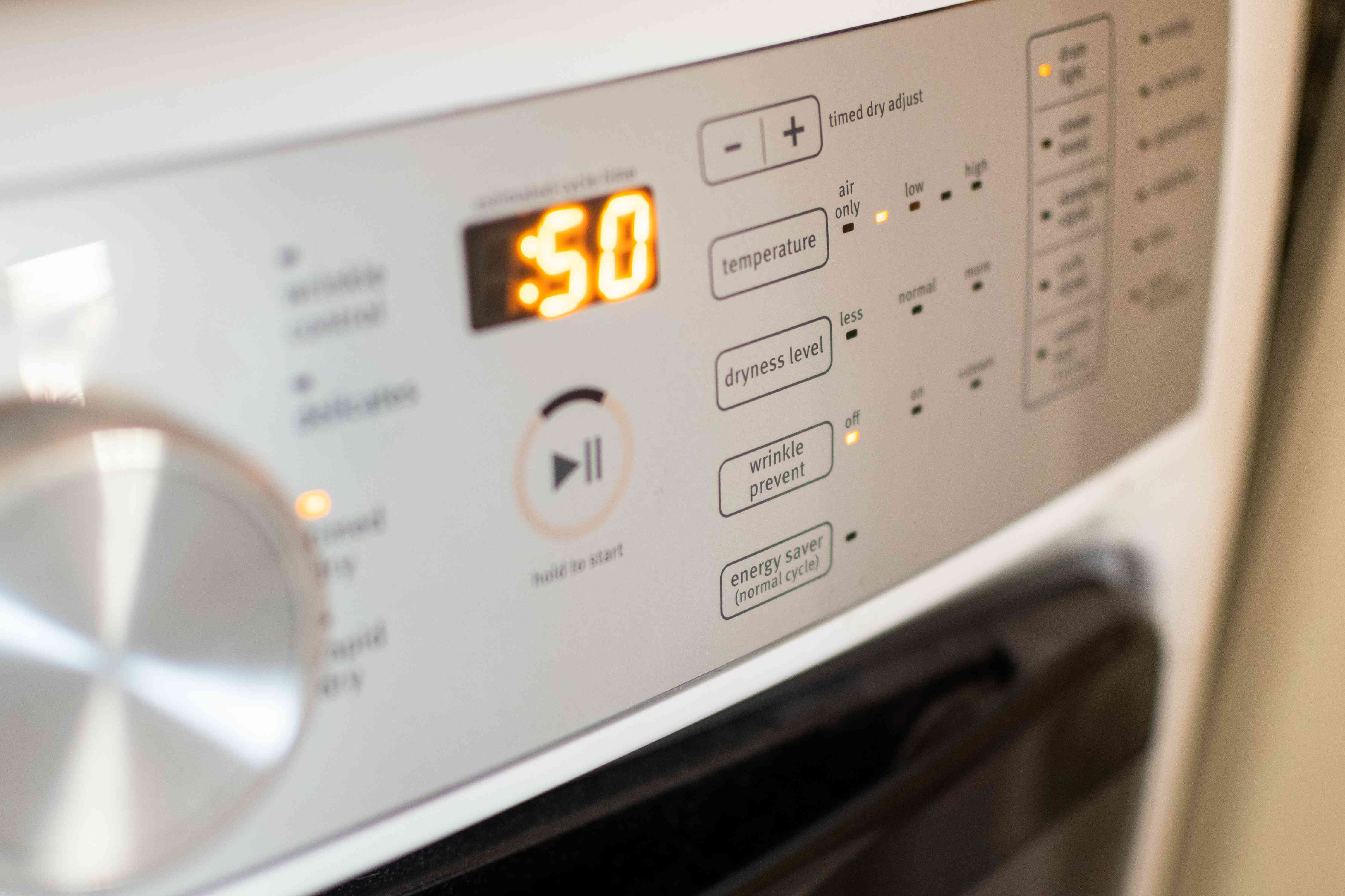 Drying machine set to low heat for down coats