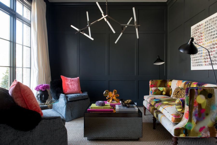 black living room with bold pops of color