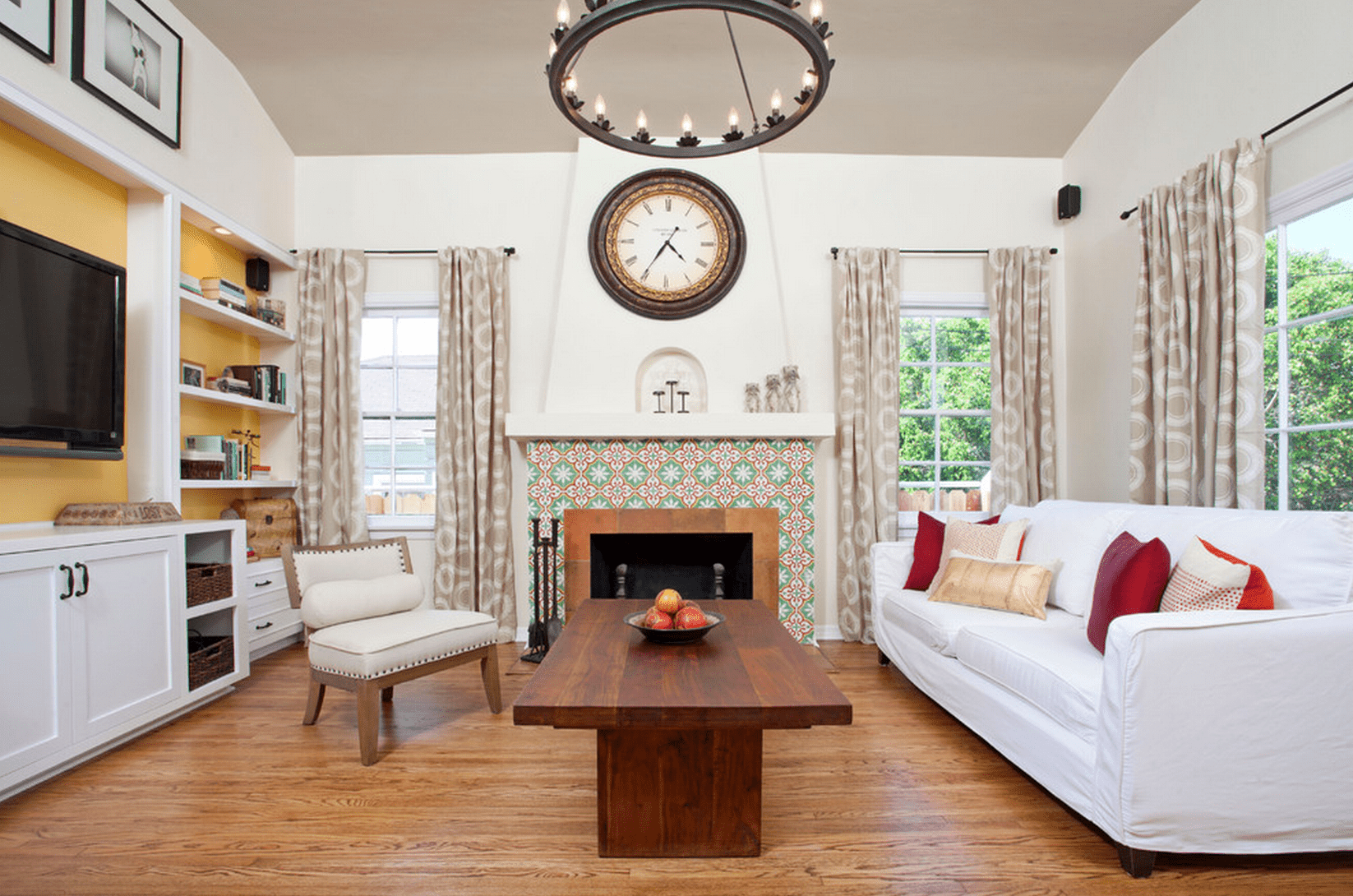 Living room with colorful and patterned fireplace surround