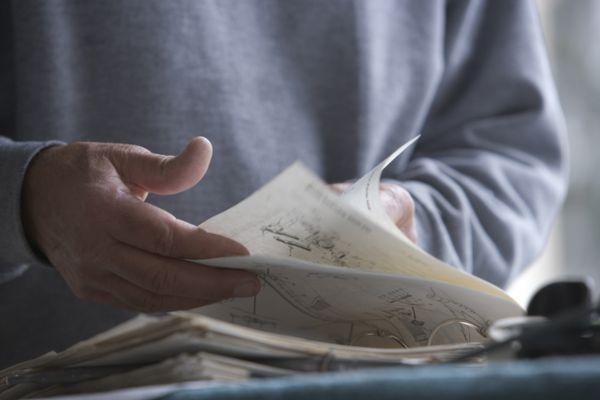 Man looking through a manual