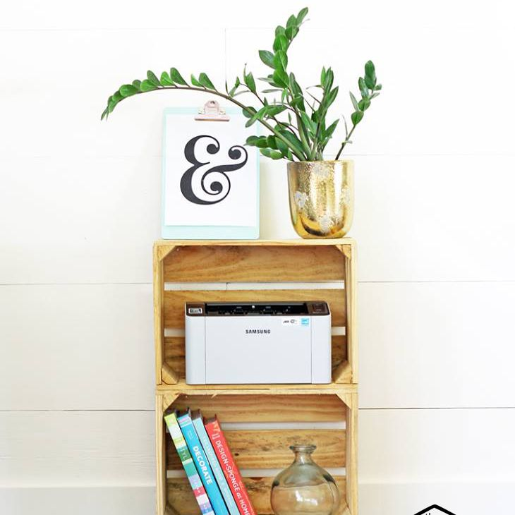 Using wooden crates to house books and other furnishings.